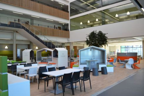 The social space has dining tables and cafe style seating