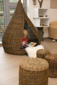 a child reads alone in a tipi