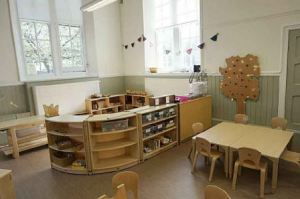 the new room is bright with wooden furnishings