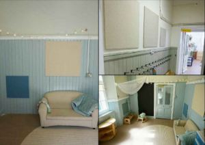 Neutral coloured pin boarding above the coat hooks in the corridor and a room that is like a living room