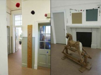 A ruler for children to measure their height and a rocking horse in the corridors