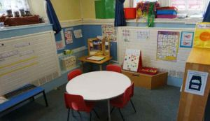 A break out space in a corner of the room with a table and chairs