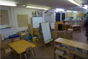 a block play cabinet and an art area next to a teaching area