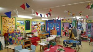 the classroom had a few tables and chairs, and bright, colourful decoration