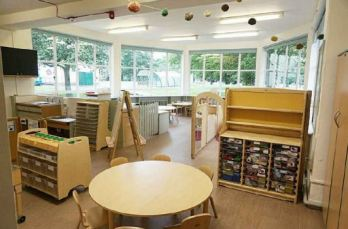 the furnishings are wooden, a large circular table with seats and lots of good storage