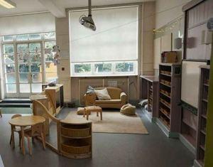 the teaching area looks like a living room with a sofa and a rug