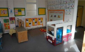 a construction corner with a play bus