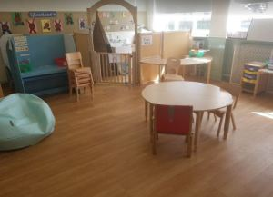 A tipi for a child to feel safe in is in an enclosed space in the classroom