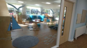 graphics pf sailing boats and fish on the window to the classroom
