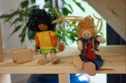 Wooden toys for a dolls house, two wooden people