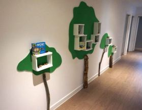 Cube shelves wall mounted on the decorative trees