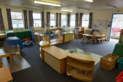 the nursery classroom looks dark, it has dark carpet and curtains