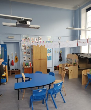 a U shaped teaching table and two workstations