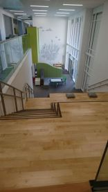 Steps and seating leading down to a shared breakout space