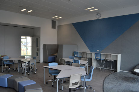 the classroom has decorative pinboarding and flexible furniture
