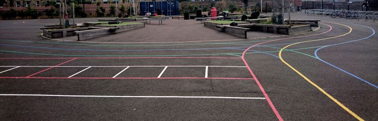a tarmac playground with colourful line markings