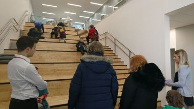 The stairway that has standard steps to the right and large stepped seating on the left
