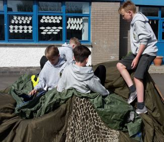 Four boys are creating a den