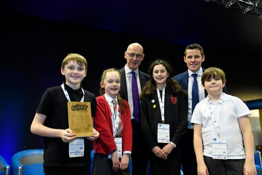 Four children from Corstorphine primary pose with their trophy alongside Depute First Minister John Swinney, and Richard Park from HUB South East