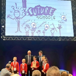 five children from St John Vianney's primary pose with their trophy alongside Depute First Minister John Swinney, and Richard Park from HUB South East