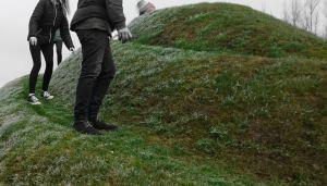 people walking on a mound